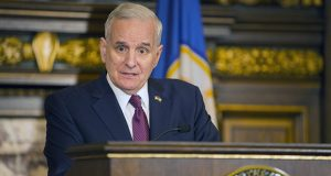 """Gov. Mark Dayton addresses reporters on April 7. He pledged to """"fight very hard"""" during the legislative session's remaining five weeks for Supreme Court Chief Justice Lorie Gildea's full 2018-19 budget request. (Staff photo: Kevin Featherly)"""