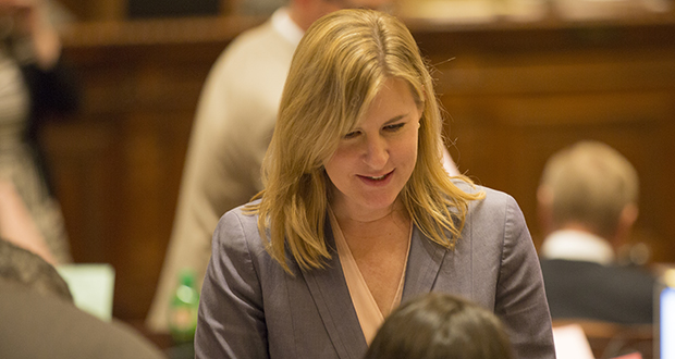 """Rep. Melissa Hortman, DFL-Brooklyn Center, chats with a colleague Monday. Her comments several hours later about breaking up a """"100 percent white male card game"""" going on outside House chambers led Taxes Committee Chair Greg Davids, R-Preston, to call for her resignation as minority leader. Davids later revised his comments, saying Hortman needs to apologize to the body. (Staff photo: Kevin Featherly)"""