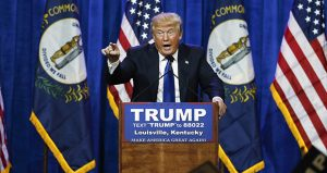 On March 1, 2016, then-candidate Donald Trump spoke during a rally in Louisville, Kentucky. A federal judge has rejected Trump's free-speech defense against a lawsuit accusing him of inciting violence against protesters during his campaign. (AP file photo)