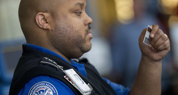 A Transportation Security Administration officer checks passengers' identification at a security checkpoint at Ronald Reagan National Airport in Washington, D.C. (Bloomberg News file photo)