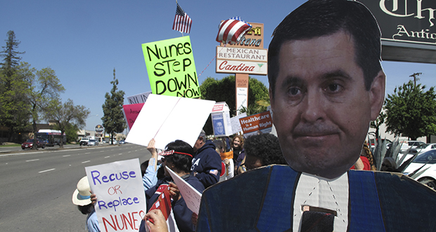 Protesters hold up a cutout of Rep. Devin Nunes, who visited Fresno, California, on March 31. Nunes, a Republican, is facing intense criticism as chair of the House Intelligence Committee for his handling of an investigation into Russian meddling of the 2016 presidential election. (AP photo)
