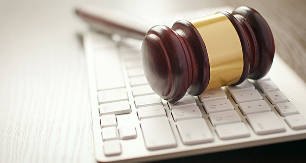 Wooden gavel on a computer keyboard
