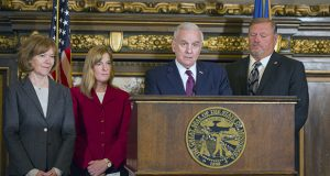 Gov. Mark Dayton reacts Tuesday to GOP leaders' decision to push forward conference committee reports not yet negotiated with the governor. Last-ditch negotiations broke down later Tuesday and a bevy of policy-laden finance bills were sent to the House and Senate floors. Pictured with Dayton are Lt. Gov. Tina Smith, House Minority Leader Melissa Hortman, DFL-Brooklyn Park, and Senate Minority Leader Tom Bakk, DFL-Cook. (Staff photo: Kevin Featherly)