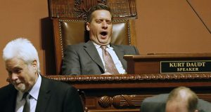 House Speaker Kurt Daudt yawns as he, chief clerk Patrick Duffy Murphy, left, and others wait for roll call to be completed during Day 3 of the special session Thursday in St. Paul. (AP photo: Jim Mone)
