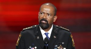 Milwaukee County Sheriff David Clarke speaks during the opening day of the Republican National Convention on July 18, 2016, in Cleveland. A jury on Monday recommended criminal charges against seven Milwaukee County jail staffers in the dehydration death of an inmate who went without water for seven days. The jail is overseen by Clarke, but the inquest did not target him. (AP file photo)