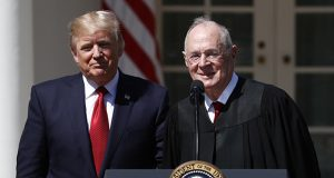President Donald Trump, left, and Supreme Court Justice Anthony Kennedy participate in the public swearing-in ceremony for Justice Neil Gorsuch on April 10 in the Rose Garden of the White House White House in Washington. (AP file photo)