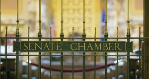 As the gate indicates, the Senate is closed for business—for now. But one of its members, Sen. John Marty, wants to stop the legislative practice of stuffing omnibus bills with policy provisions behind closed doors. (Staff photo: Kevin Featherly)