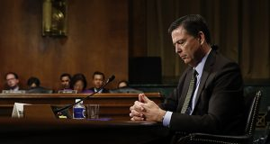 Then-FBI Director James Comey paused as he testified May 3 at a Senate Judiciary Committee hearing on Capitol Hill in Washington. (AP photo)