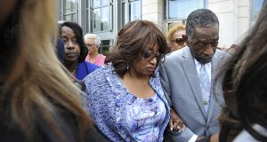 In this May 11 photo, Bishop Rudolph W. McKissick Sr., right, escorts former U.S. Rep. Corrine Brown outside the courthouse in Jacksonville, Florida. Brown was found guilty of taking money from a charity that was purported to be giving scholarships to poor students. (AP photo: The Florida Times-Union)
