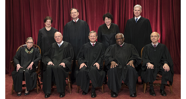 The justices of the U.S. Supreme Court gather for an official group portrait to include new Associate Justice Neil Gorsuch, top row, far right. Seated, from left are, Associate Justice Ruth Bader Ginsburg, Associate Justice Anthony M. Kennedy, Chief Justice John Roberts, Associate Justice Clarence Thomas, and Associate Justice Stephen Breyer. Standing, from left are, Associate Justice Elena Kagan, Associate Justice Samuel Alito Jr., Associate Justice Sonia Sotomayor, and Associate Justice Neil Gorsuch. (AP photo: J. Scott Applewhite)