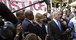 Gov. Mark Dayton, right, speak to protesters and media outside the governor's residence Thursday, July 7, 2016, the day after the police shooting death of Philando Castile. (AP file photo: Jim Mone)