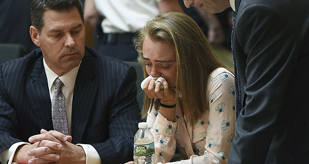 Michelle Carter cries while flanked by defense attorneys Joseph Cataldo, left, and Cory Madera, after being found guilty of involuntary manslaughter in the suicide of Conrad Roy III on Friday, June 16 in Bristol Juvenile Court in Taunton, Massachusetts. (AP photo: Fairhaven Neighborhood News)