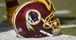 A Washington Redskins helmet is seen on the sidelines during an NFL football game. The Supreme Court on Monday struck down part of a law that bans offensive trademarks in a ruling that is expected to help the Washington Redskins in their legal fight over the team name. (AP file photo)