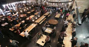 After opening its Minneapolis beer hall in 2014 with a mandatory tip pool in place, Surly twice revised its policy by scheduling worker votes to make the arrangement more voluntary. (File photo: Bill Klotz)
