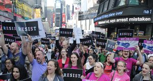 Protesters gather in Times Square on Wednesday, July 26, in New York. President Donald Trump declared a ban on transgender people serving anywhere in the U.S. military, catching the Pentagon flat-footed. (AP photo)