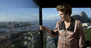 Former Brazilian President Dilma Rousseff looks out over Guanabara Bay before the start of an interview July 14 at the offices of the Associated Press in Rio de Janeiro. Rousseff was impeached last year for manipulating the fiscal budget. (AP photo: Silvia Izquierdo)