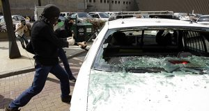 A new criminal law establishes four ways to trigger a first-degree criminal charge for damage to a public safety vehicle. In this photo, protesters smash the windows of a police car during the 2008 Republican National Convention in St. Paul. (AP file photo)