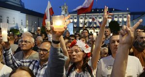 Protesters rally in front of the presidential palace in Warsaw, Poland, on Tuesday, urging President Andrzej Duda to reject a bill changing the judiciary system. (AP photo: Alik Keplicz)