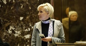 """Mika Brzezinski waits for an elevator in the lobby at Trump Tower on Nov. 29, 2016, in New York. President Donald Trump has used a series of tweets to go after Brzezinski and Joe Scarborough, who've criticized Trump on their MSNBC show """"Morning Joe."""" (AP file photo)"""