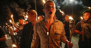 White nationalist groups march with torches Aug. 11 through the University of Virginia campus in Charlottesville. (AP photo: Indianapolis Star)