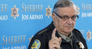 Former Maricopa County Sheriff Joe Arpaio, shown at a 2013 news conference, was convicted of a criminal charge Monday for refusing to stop traffic patrols that targeted immigrants. (AP file photo)