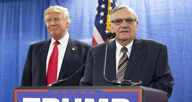 On Jan. 26, 2016, then-Republican presidential candidate Donald Trump was joined by Joe Arpaio, then sheriff of metro Phoenix, during a news conference in Marshalltown, Iowa. (AP file photo)