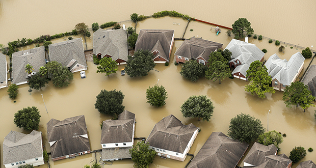 Floodwaters from the Addicks Reservoir inundate a Houston neighborhood Wednesday in the aftermath of Hurricane Harvey. (AP photo: Houston Chronicle)