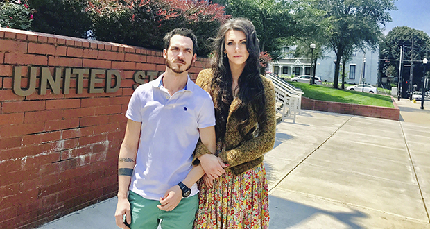 This photo provided by Jillian Weiss shows Dane Lane, left, and his transgender wife, Allegra Schawe-Lane, outside the federal courthouse in Covington, Kentucky. (AP photo)