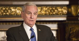 Gov. Mark Dayton speaks to reporters in his Capitol reception room Tuesday. The governor said a constitutional ballot initiative might be needed to maintain the judiciary as an emergency funding source in budget impasses. (Staff photo: Kevin Featherly)