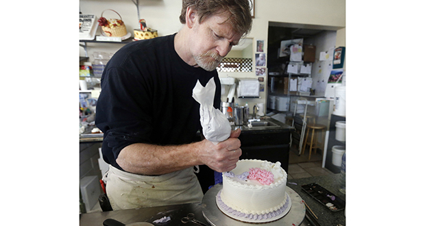 In this 2014 photo, Masterpiece Cakeshop owner Jack Phillips decorates a cake inside his store in Lakewood, Colorado. Last year, Colorado's Supreme Court has refused to take up the case of Phillips, who would not make a wedding cake for a same-sex couple, letting stand a lower court's ruling that Phillips cannot cite his Christian beliefs in refusing service. The dispute is now before the U.S. Supreme Court. (AP file photo)
