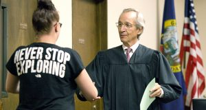 Judge John Stegner congratulates Starr Olson and give her a certificate during Latah County Mental Health Court on Sept. 11 in Moscow, Idaho. (AP photo: Moscow-Pullman Daily News)