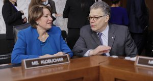 """Senate Judiciary Committee members Sen. Amy Klobuchar and Sen. Al Franken talk during a break in Supreme Court nominee Neil Gorsuch's confirmation hearing on March 21. The Minnesota Democrats will not submit their so-called """"blue slips"""" to move forward state Supreme Court Justice David Stras' nomination to the federal bench. (AP file photo)"""