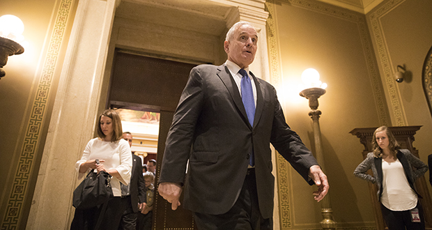 Gov. Mark Dayton leaves the Supreme Court courtroom in the Capitol after oral arguments Aug. 28 in his legislative funding impasse with lawmakers. (AP file photo: Star Tribune)