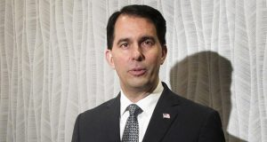 """Wisconsin Gov. Scott Walker said in a statement: """"I applaud the court in affirming the constitutional right of all Wisconsin workers to be free to choose whether they want to join a union or financially support a union."""" (AP file photo)"""