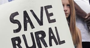 A girl holds a sign at a rally held Sept. 16, 2016, in Raleigh, North Carolina, imploring state lawmakers to save a hospital in the town of Belhaven. (AP file photo: The News & Observer)