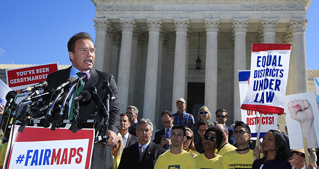 Former California Gov. Arnold Schwarzenegger speaks Tuesday at a rally outside the U.S. Supreme Court in Washington. The court heard arguments in a case about political maps in Wisconsin that could affect elections across the country. (AP photo)