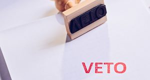 Law act with red veto stamp.