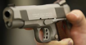 A person holds a handgun for sale at a store in Orem, Utah. (Bloomberg file photo)