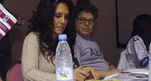 In this image provided by the U.S. Army, sportscaster Leeann Tweeden and then-comedian Al Franken greet military members during an autograph-signing session of the USO Sergeant Major of the Army's 2006 Hope and Freedom Tour in Camp Arifjan, Kuwait, on Dec. 14, 2006. Franken apologized after Tweeden accused him of forcibly kissing her during the 2006 USO tour. (AP photo: Sgt. Thomas Day, U.S. Army)