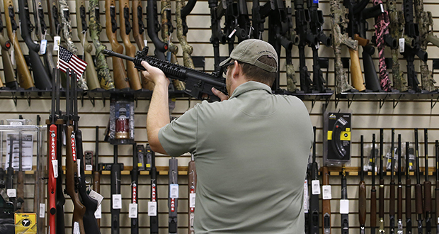 A customer holds an AR-15 rifle at a gun store in Orem, Utah. In a Maryland case, a federal appeals court said assault weapons, including the popular AR-15, aren't protected by the Second Amendment. (Bloomberg file photo)