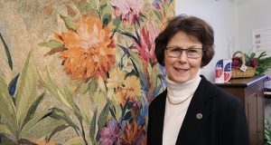 Rep. JoAnn Ward, DFL-Woodbury, is an avid gardener and has a tapestry with a floral pattern on her office wall at the State Office Building in St. Paul. (Staff photo: Bill Klotz)