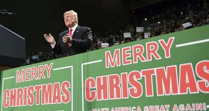 "President Donald Trump takes to the stage Dec. 8 at a campaign-style rally at the Pensacola Bay Center, in Pensacola, Florida. There's no mistaking Trump's ""Merry Christmas"" message: He wields it as a weapon against what his supporters call political correctness. (AP file photo)"