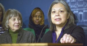 Rep. Susan Allen, right, speaks to reporters Dec. 8 as Rep. Karen Clark, left, listens. The two Minneapolis DFLers announced that they would not seek re-election. (Staff photo: Kevin Featherly)
