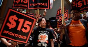 Demonstrators rally for a $15 minimum wage this June in New York. (AP file photo)