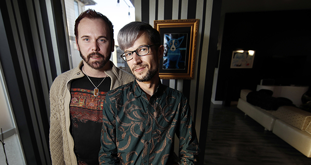 Charlie Craig and David Mullins are shown in their home in Denver. The Supreme Court heard arguments Tuesday in the case of a baker who refused to make a cake for the same-sex couple. (AP photo)
