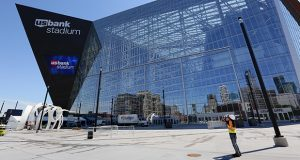 Downtown Minneapolis is reflected on the side of U.S. Bank Stadium, which will host the Super Bowl Feb. 4. Starting the week of January 29, legal teams and their clients should be prepared for impacts to regular court calendars in downtown Minneapolis. (File photo: Bill Klotz)
