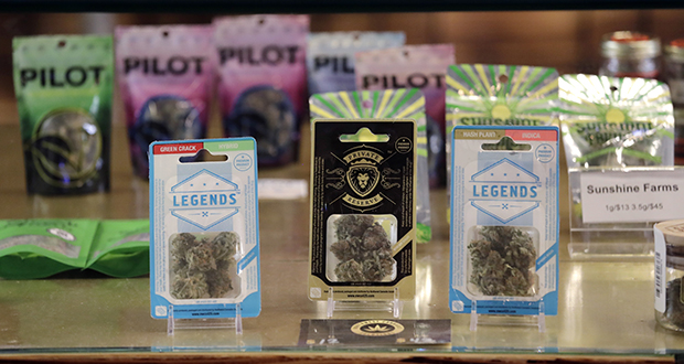 Marijuana products fill a display cabinet Thursday in the Herban Legends pot shop in Seattle. (AP photo)