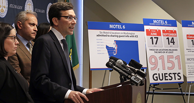 Washington state Attorney General Bob Ferguson addresses a news conference Wednesday in Seattle, announcing that his office is suing Motel 6. Ferguson said that the budget hotel disclosed the personal information of thousands of guests to federal immigration authorities in violation of state law. (AP photo)