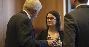Destiny Dusosky, center, a DFL activist from Sauk Center, sued Michelle Fischbach in January, hoping to persuade a judge to have her removed as senator. (AP pool photo)