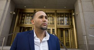 Iraq war veteran Jose Belen, who takes marijuana to treat post-traumatic stress disorder, poses in front of federal court Tuesday in New York. Belen is one of five plaintiffs in a lawsuit challenging federal marijuana laws. (AP photo: Mark Lennihan)